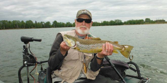Bill Pollock holding a brown trout from West Goose Lake.