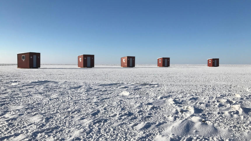 Five ice fishing shacks are set up on the ice Thursday near Sunset Beach on Lake Winnipeg. The shacks are a new venture for entrepreneurs Curtis Beyak and Terry Roth, who have launched Lake Winnipeg Ice Fishing Shack Rentals on the east side of the lake about an hour north of Winnipeg. (Submitted photo)
